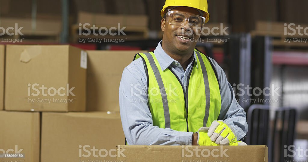 Portrait of worker in warehouse stock photo
