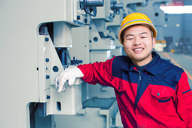 portrait of worker portrait of worker migrant worker stock pictures, royalty-free photos & images