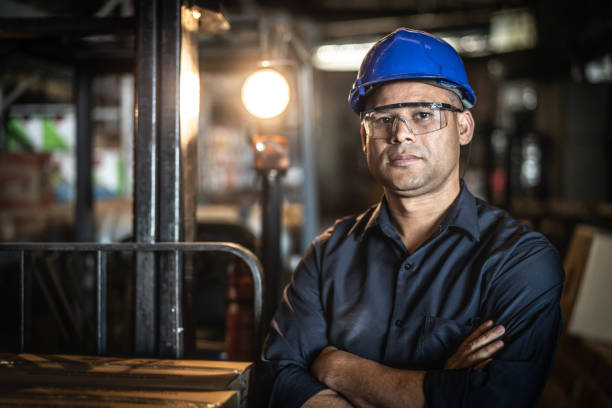 portrait of worker - manufacturing occupation stock photos and pictures