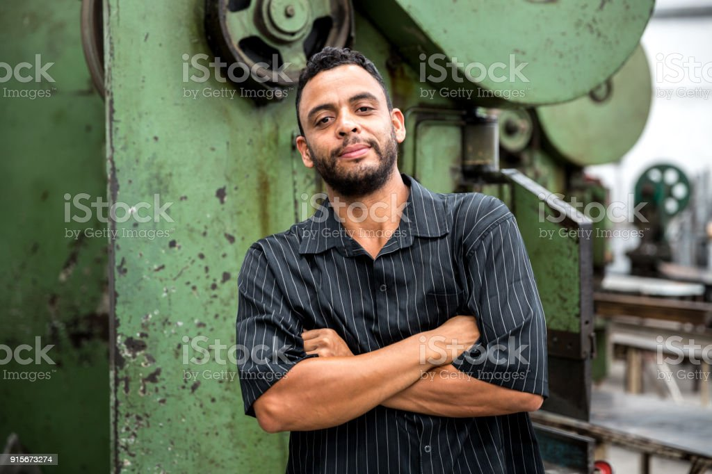 Portrait of Worker with his arms crossed at Factory royalty-free stock photo