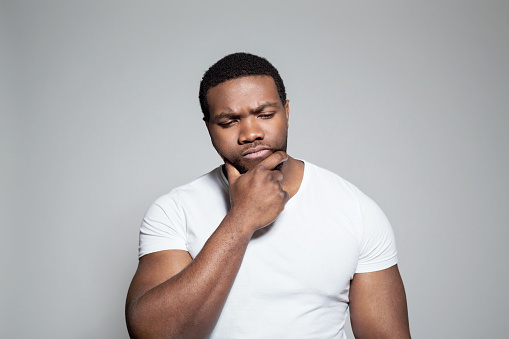 Portrait Of Worried Afro American Young Man Stock Photo - Download Image Now