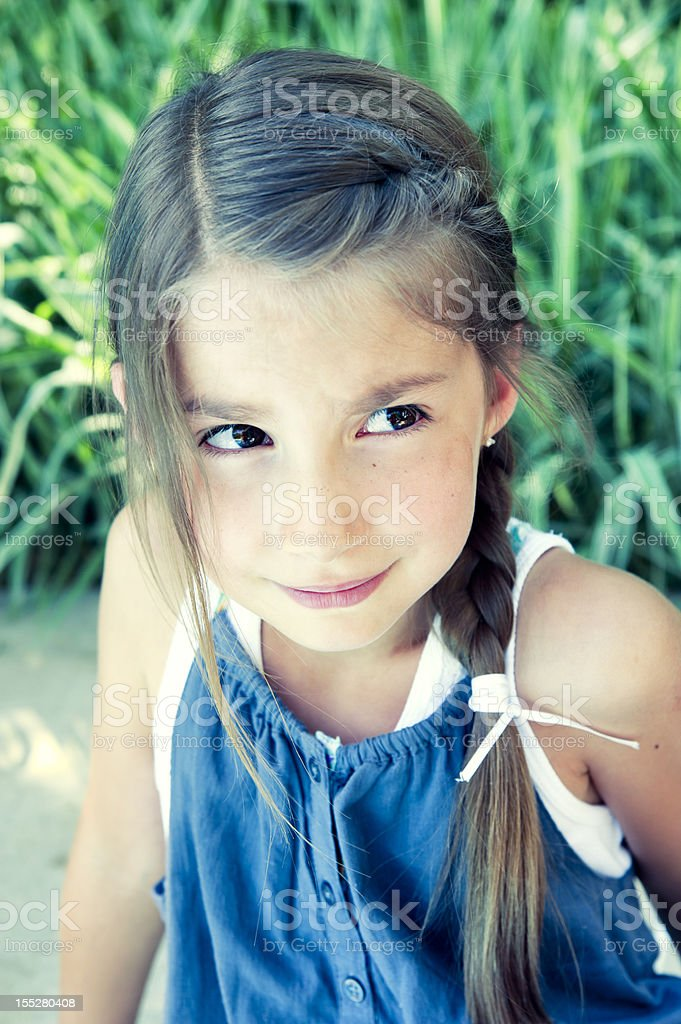 Portrait of worried little girl by the pool. royalty-free stock photo