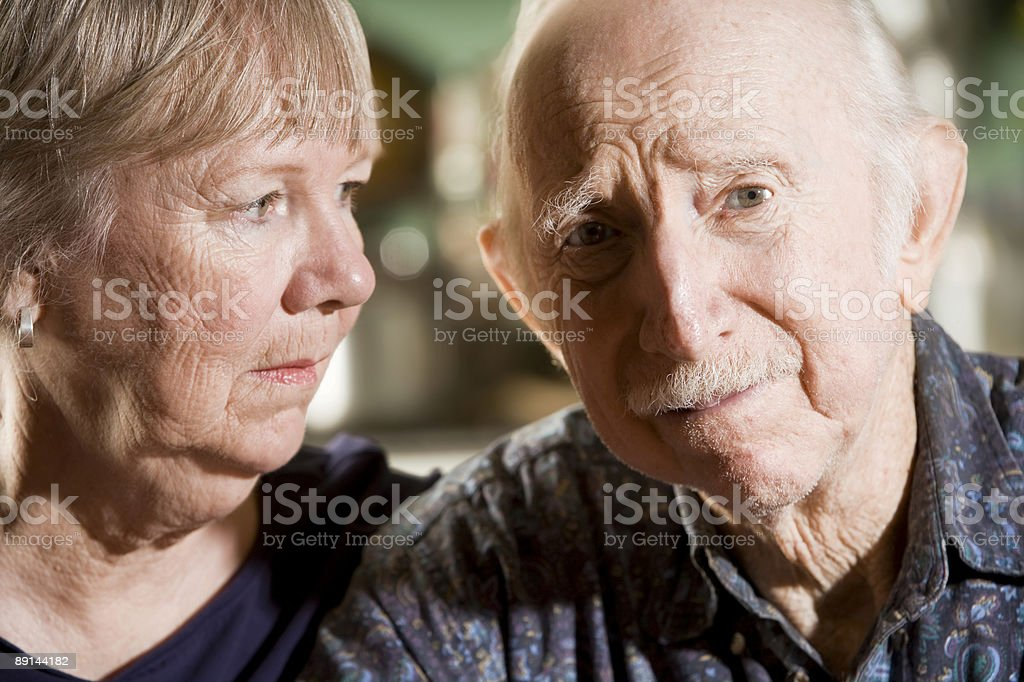 Portrait of Worried Senior Couple stock photo
