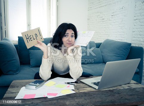 istock Portrait of worried young woman feeling stressed and desperate asking for help in paying bills, debts, tax expenses and accounting home finances with laptop. In online banking and financial problems. 1143509612