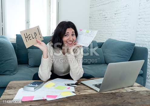 istock Portrait of worried young woman feeling stressed and desperate asking for help in paying bills, debts, tax expenses and accounting home finances with laptop. In online banking and financial problems. 1143510038