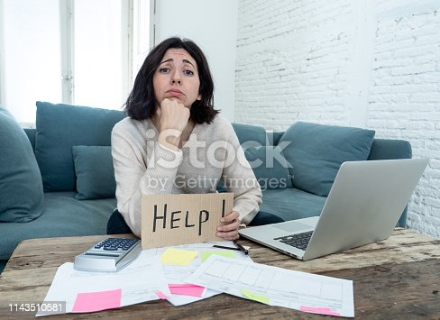 istock Portrait of worried young woman feeling stressed and desperate asking for help in paying bills, debts, tax expenses and accounting home finances with laptop. In online banking and financial problems. 1143510581
