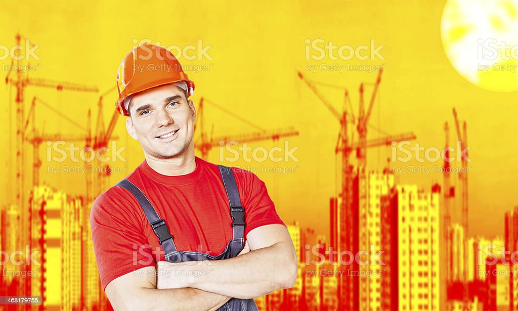 Portrait of young adult smiling handsome construction worker royalty-free stock photo