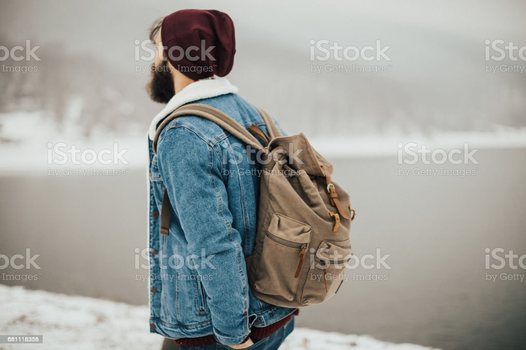 Portrait of young adventurist in the hills covered with snow stock photo