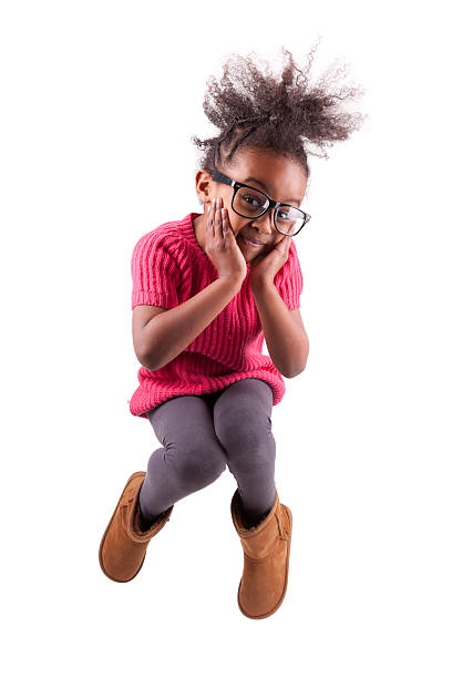 portrait of young african american girl jumping - african youth jumping for joy stock photos and pictures