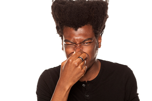 Image result for black man closing his nose