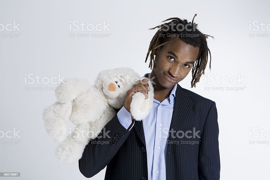 Portrait of young African American man holding teddy bear royalty-free stock photo