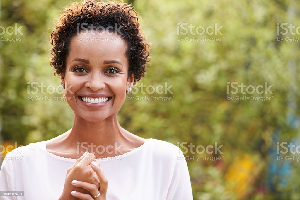 Portrait of young African American woman, horizontal stock photo