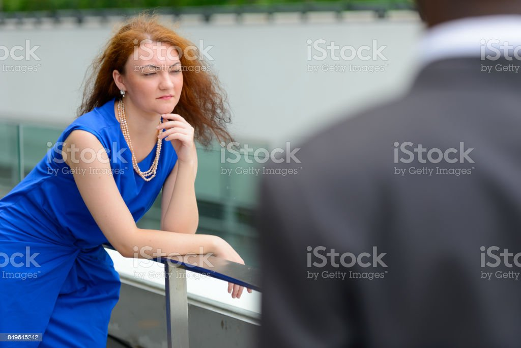 Portrait of young African businessman and young businesswoman together against view of the city in Bangkok Thailand stock photo