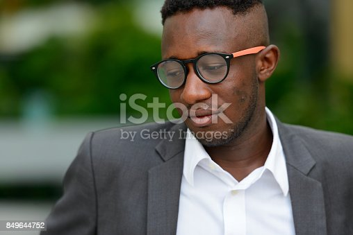 istock Portrait of young African businessman wearing suit outside the building at Bangkok Thailand 849644752