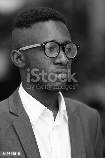 istock Portrait of young African businessman wearing suit outside the building at Bangkok Thailand 849644818