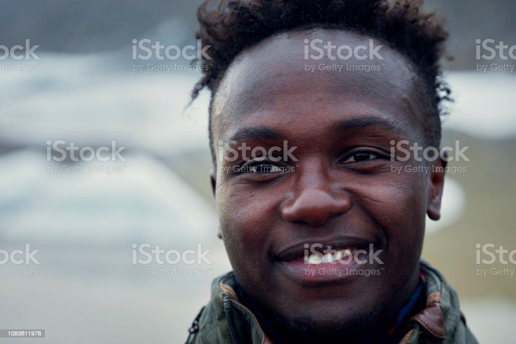 Young man posing on glacier lagoon