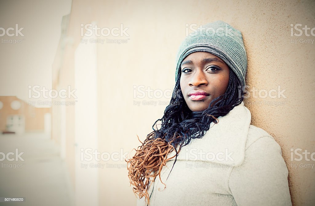 Portrait of young African pensive woman outdoors stock photo