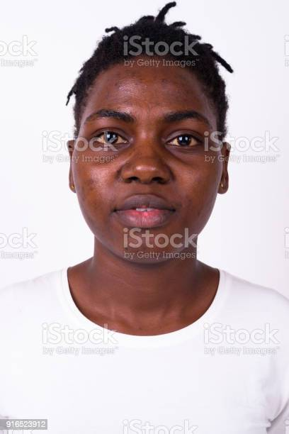 Portrait of young african woman against white background picture id916523912?b=1&k=6&m=916523912&s=612x612&h=nyltcohz7sy3zr f6tcjdfijscpivd9ilg8fr3t553u=