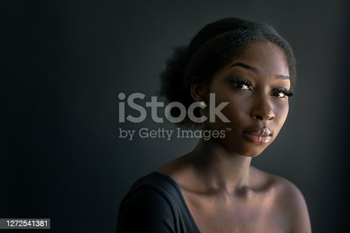 Low-key Portrait of young African-Australian Woman