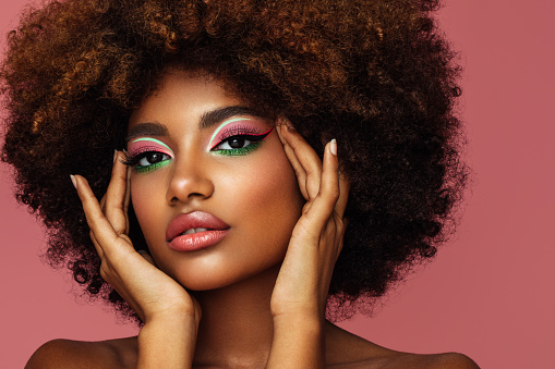 Portrait of young afro woman with bright make-up