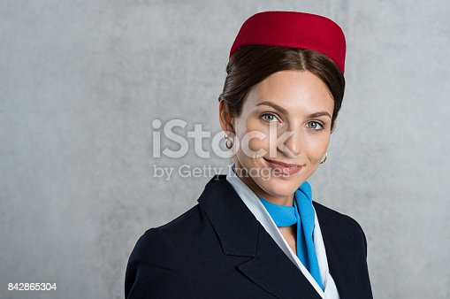 istock Portrait of young air hostess 842865304