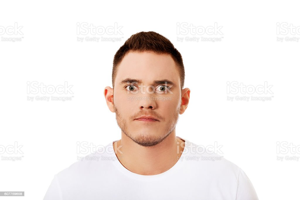 Portrait of young angry man stock photo