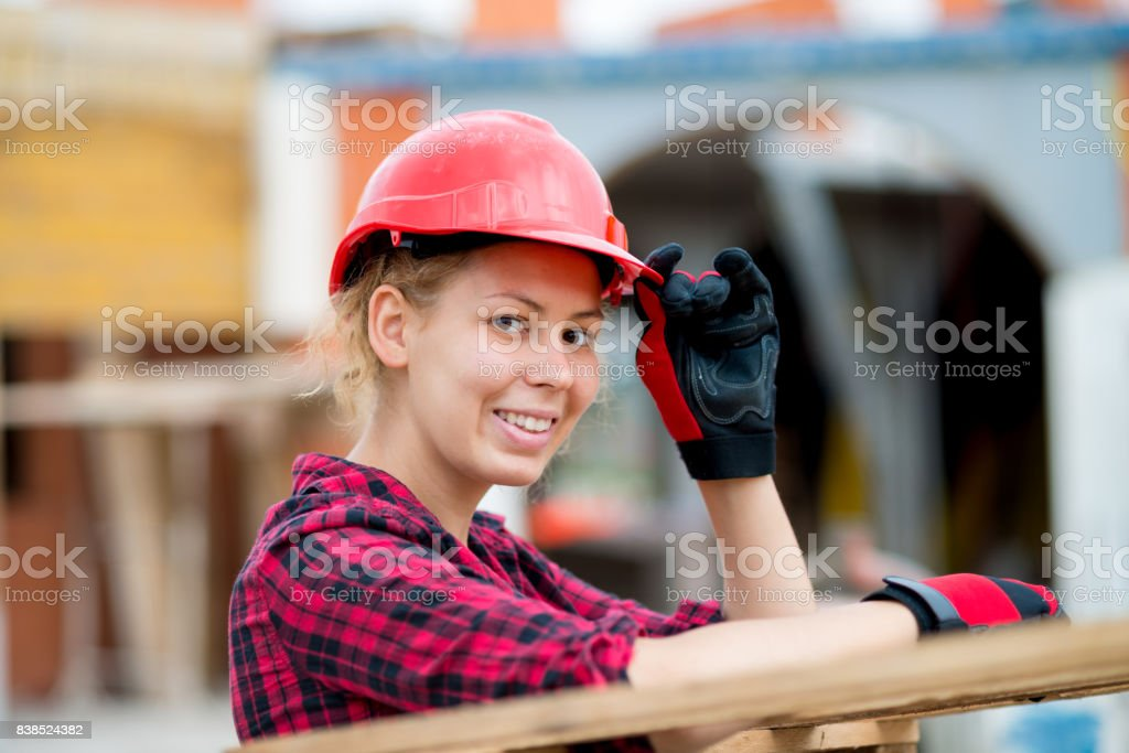 Portrait of young architect on construction site stock photo