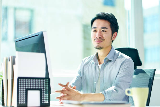 portrait of young asian business man stock photo