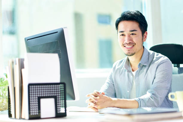portrait of young asian businessman stock photo