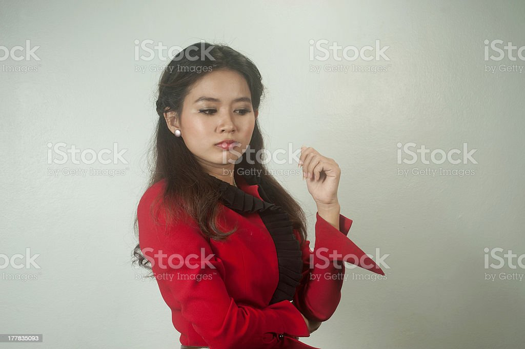 Portrait of young Asian businesswoman thinking . royalty-free stock photo