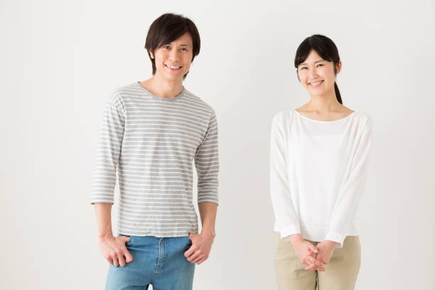 若いアジアのカップルのリラックスの肖像画 ストックフォト