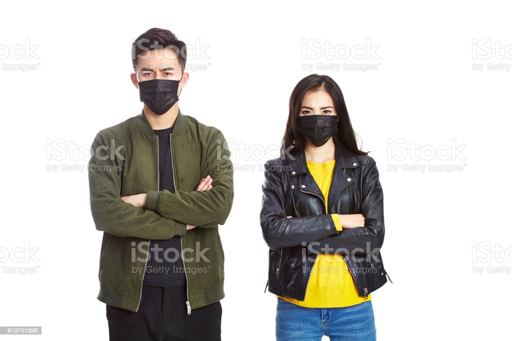 portrait of young asian couple wearing black mask stock photo