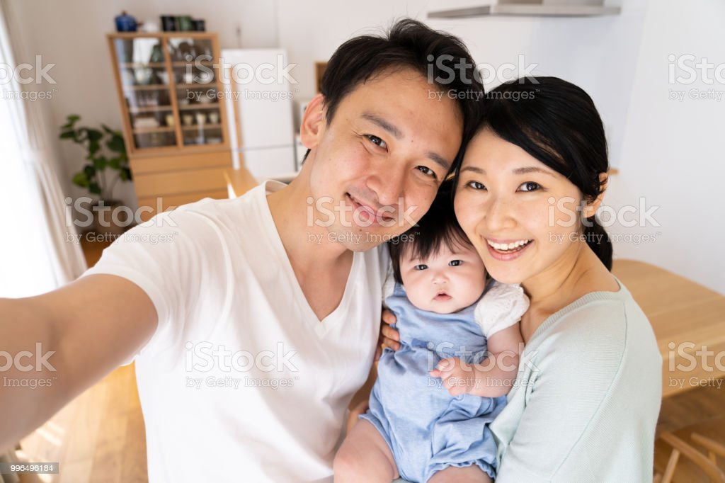 portrait of young asian family stock photo