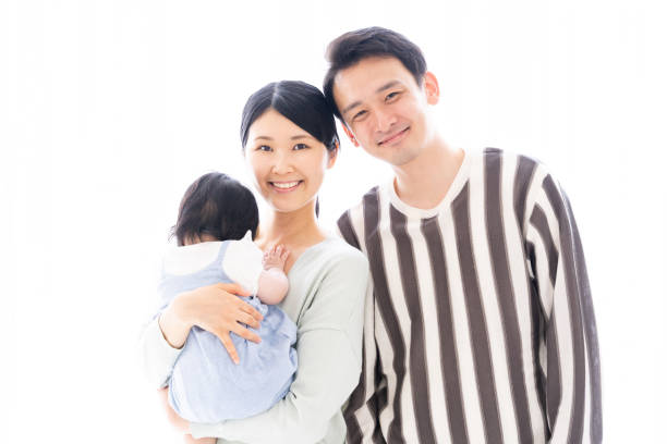 84bd3d9679bc portrait of young asian family stock photo
