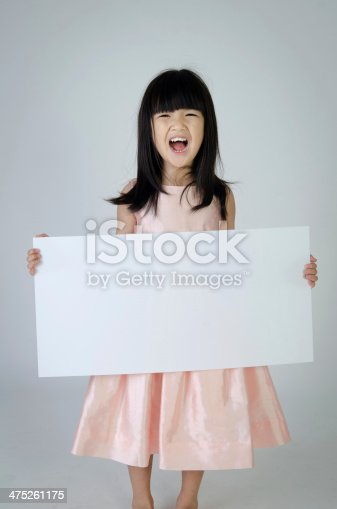 933380808istockphoto Portrait of young Asian girl holding blank billboard 475261175