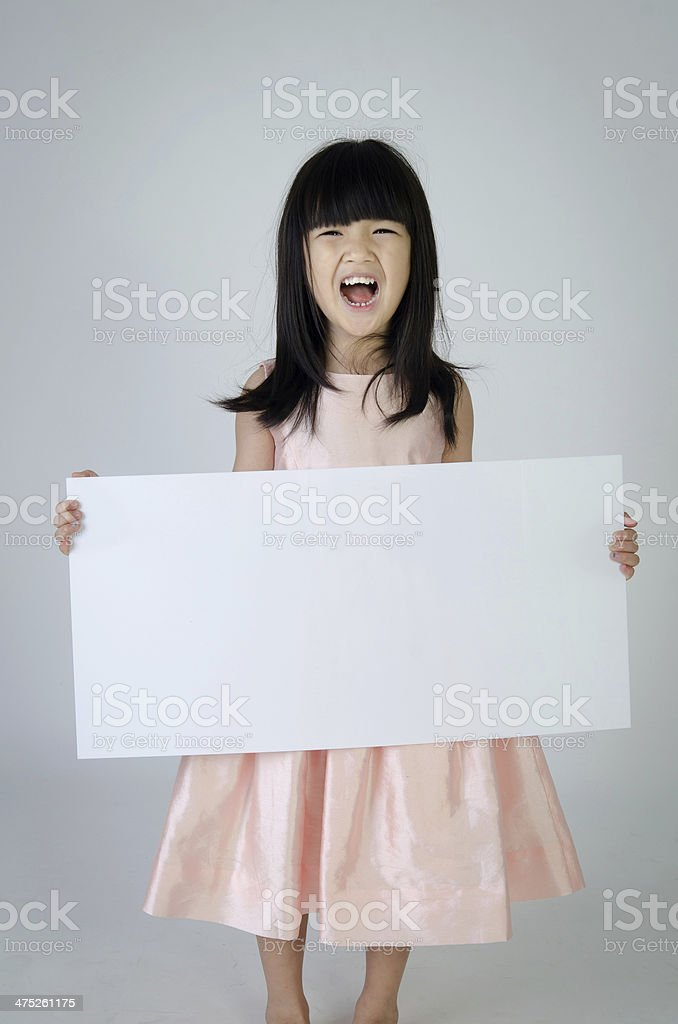Portrait of young Asian girl holding blank billboard stock photo