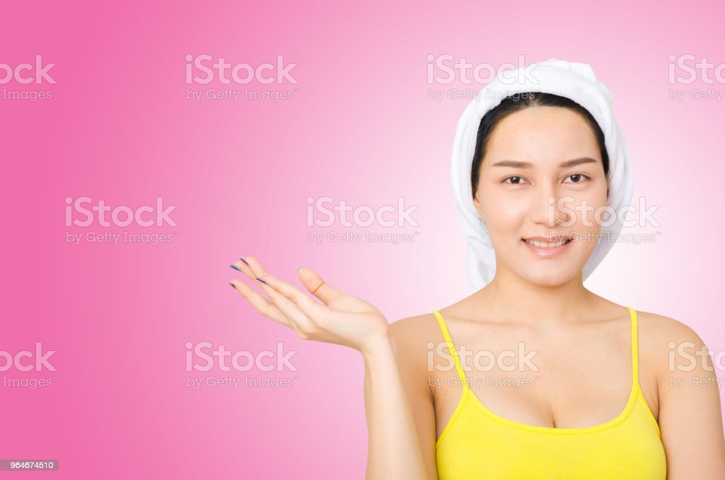 portrait of young asian girl on pink background with copy space for text advertising. perfect girl skin face care concept. royalty-free stock photo