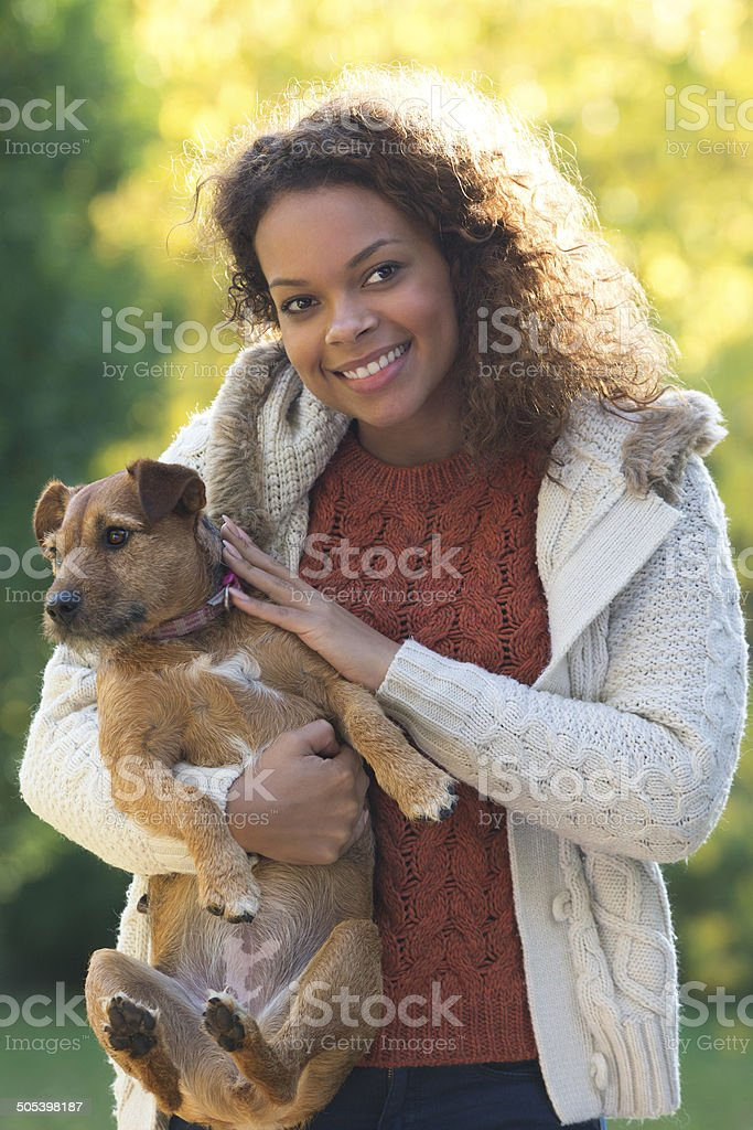 Portrait of Young Asian Woman and Her Dog royalty-free stock photo