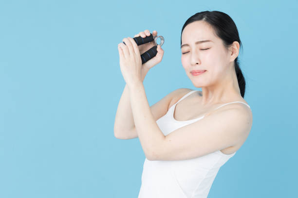 portrait of young asian woman beauty image on blue background - hand grip stock photos and pictures