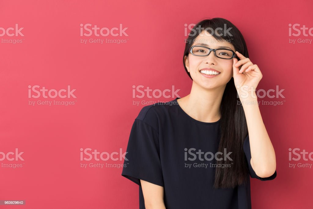 portrait of young asian woman isolated on red background - Royalty-free 20-29 Years Stock Photo