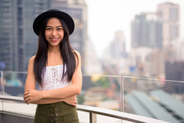 Portrait Of Young Asian Woman Portrait Of Young Happy Asian Woman From Thailand Smiling suspenders stock pictures, royalty-free photos & images