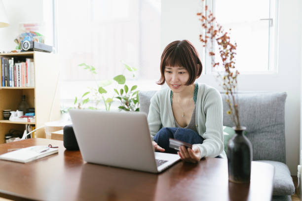 Portrait of Young Asian Woman Shopping Online stock photo