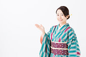 portrait of young asian woman wearing kimono isolated on white background