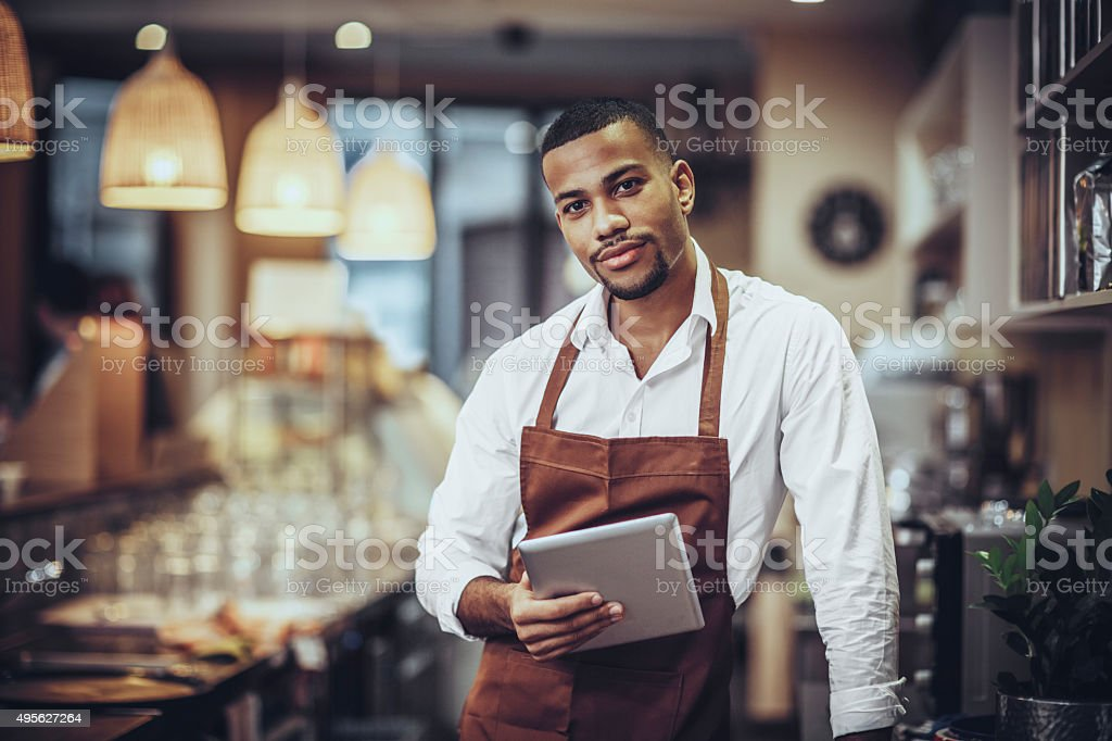 Portrait of Young barista in cafe shop stock photo