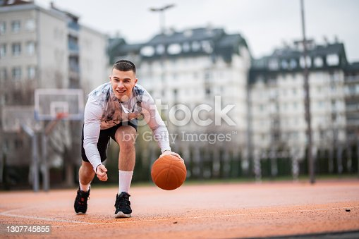 Man with ball looking away