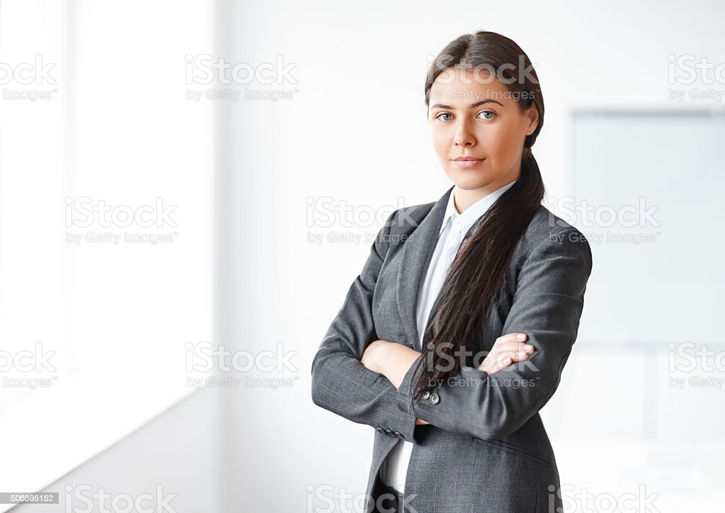 Portrait of young beautiful business woman in the office stock photo