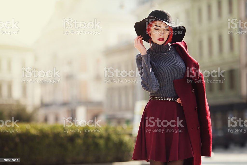 Portrait of young beautiful fashionable woman posing on the street stock photo