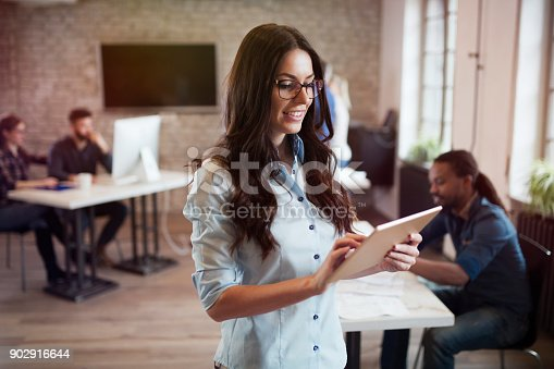 istock Portrait of young beautiful female designer using tablet 902916644