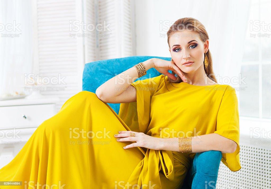 Portrait of young beautiful girl wearing long yellow dress - foto de acervo