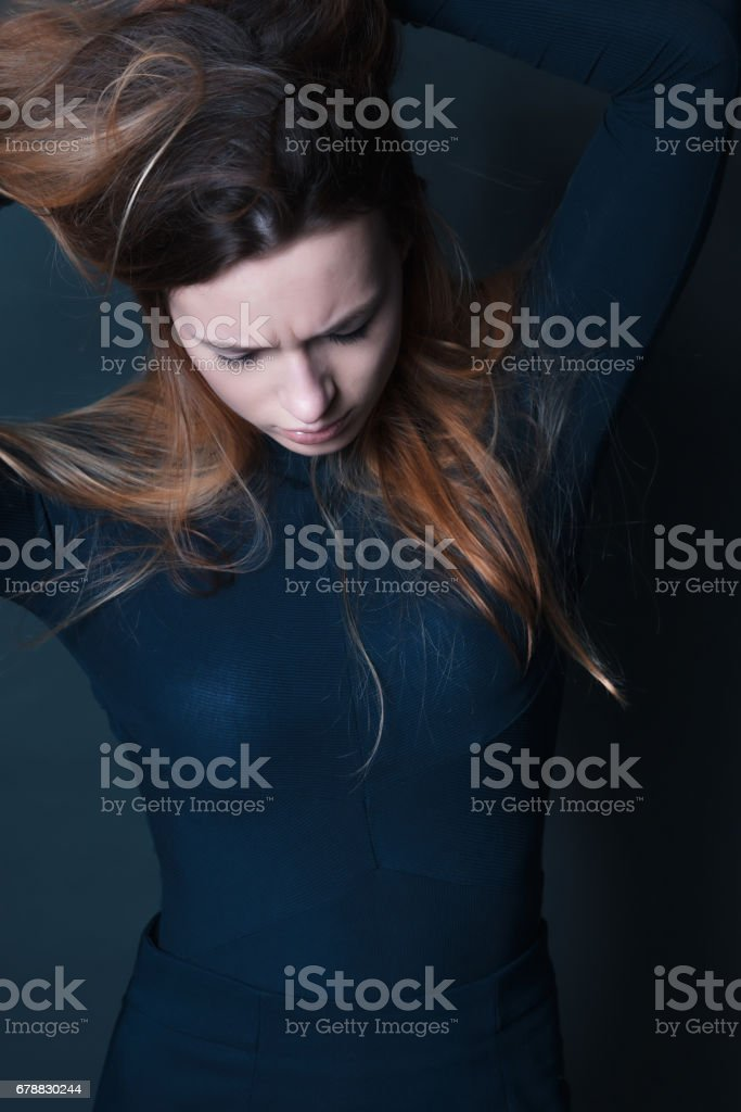 portrait of young beautiful red haired woman dancing royalty-free stock photo